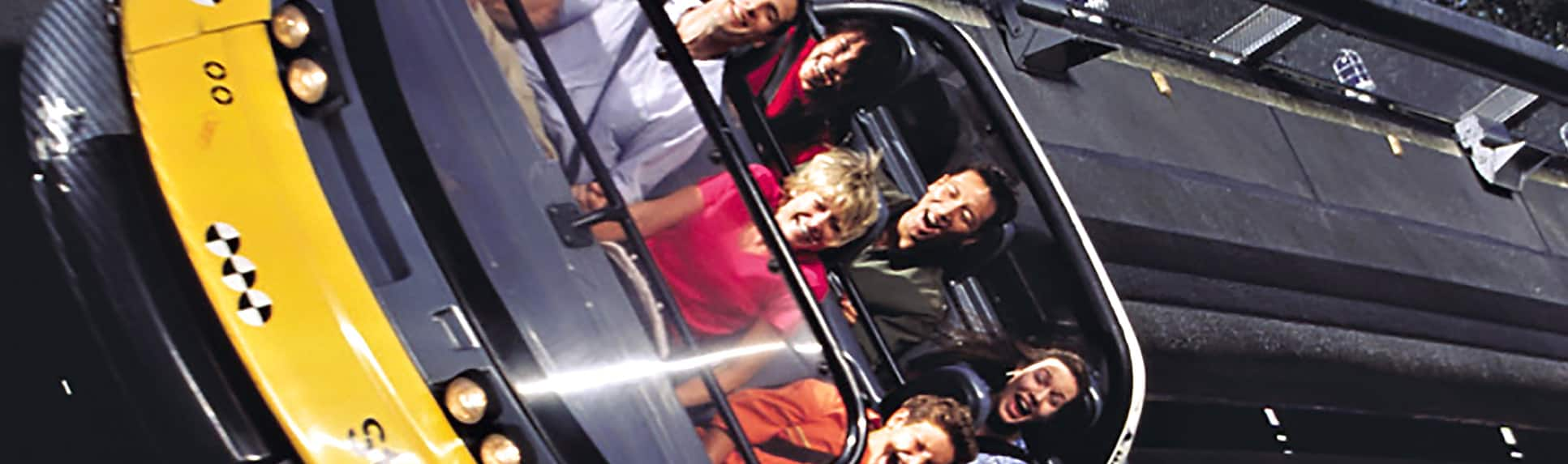 People riding the Test Track Presented by Chevrolet attraction