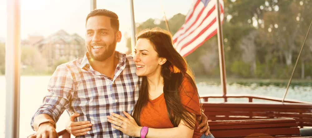A man and woman enjoy the view during a boat ride