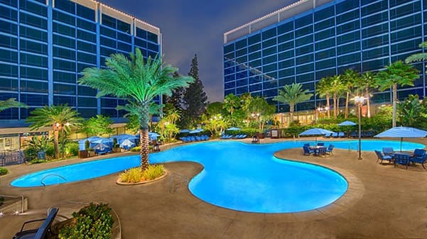 The E Ticket Pool illuminated at night at The Disneyland Hotel